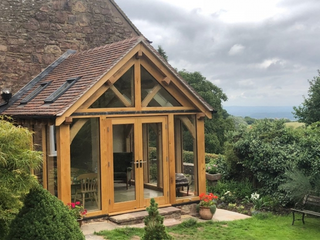 Oak framed conservatory with glass floor to ceiling