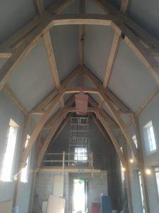 Large oak framed arch collar truss extension