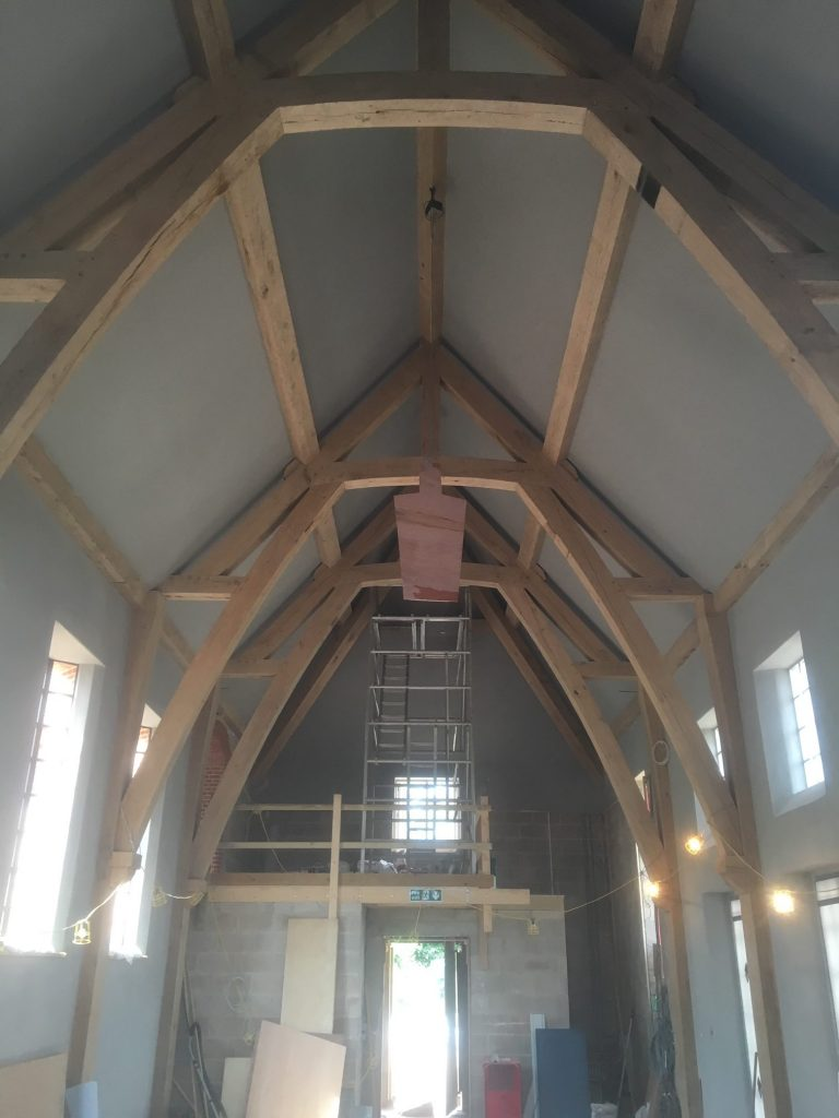 Large oak framed arch collar truss extension