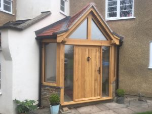Enclosed corner oak porch with solid oak door