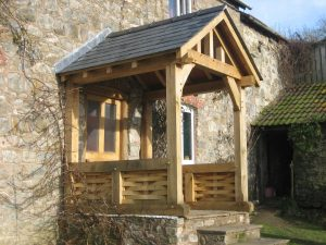Open oak framed porch with weaved panels