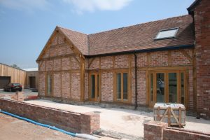 Oak framed extension with brick panels