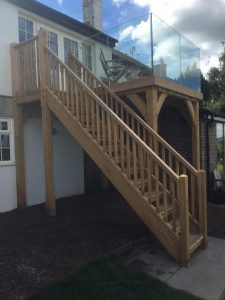 Oak balcony with glass balustrade system near monmouth