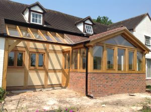 Oak Conservatory with dwarf walls and glazed lean too.