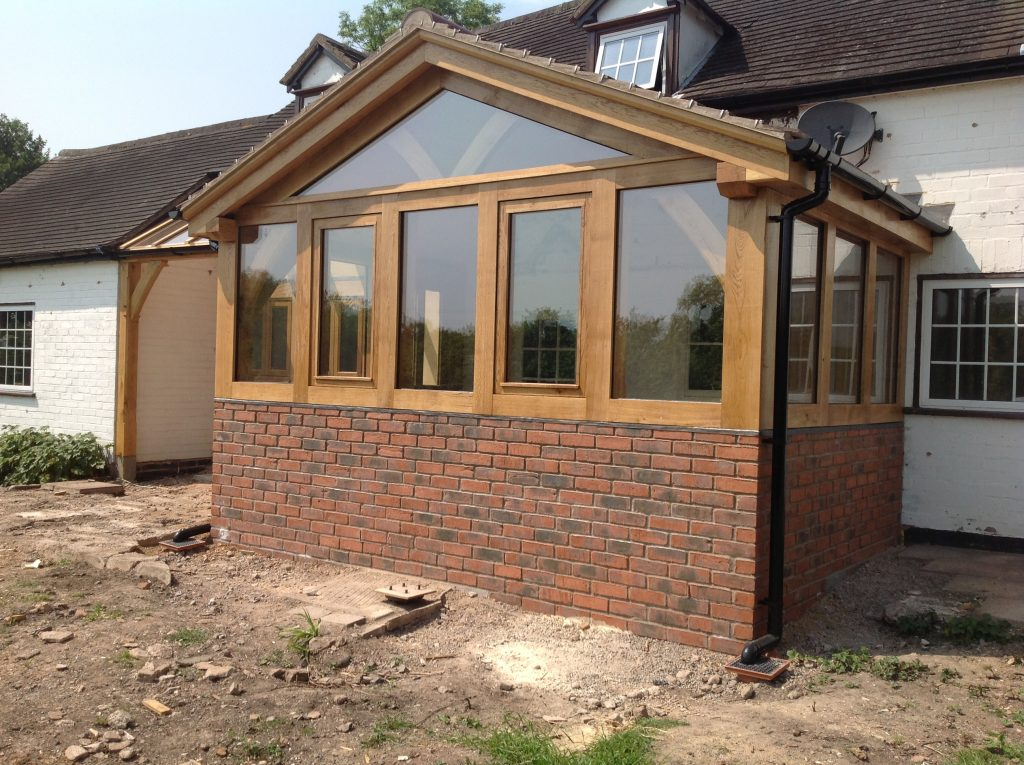 Oak Framed Conservatory on a brick dwarf wall