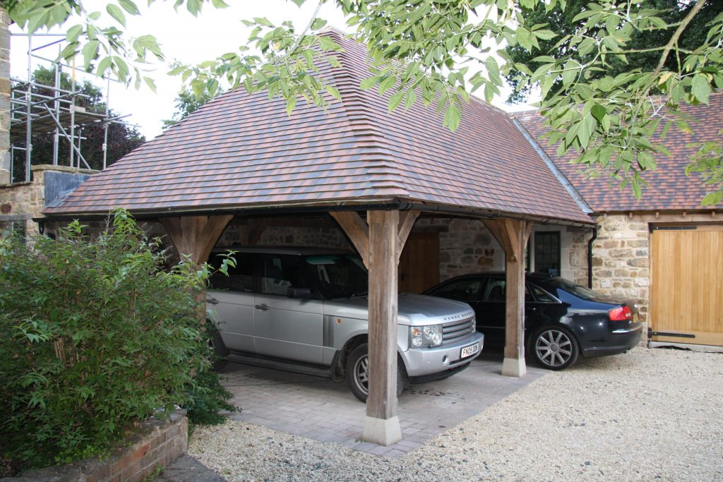 Hipped roof oak carport