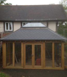 Oak Framed sun room with aluminium lantern