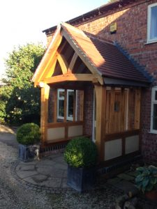 Oak porch with render panels