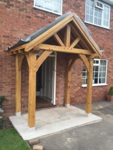 Four post oak framed porch with braces