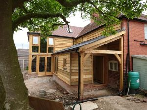Oak framed two storey extension with lean too porch