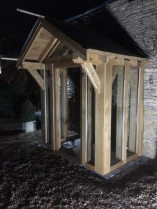 Enclosed oak framed porch with large overhang