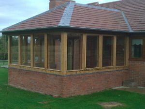 Oak framed conservatory on brick walls