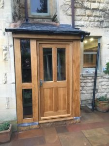 Enclosed oak framed lean too with shallow roof pitch