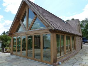 Large oak framed garden room with glass floor to ceiling