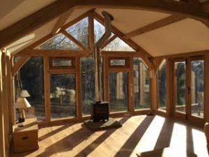 Internal view of oak framed extension garden room with glazed king post truss