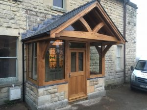 Enclosed oak porch with a feature truss overhang