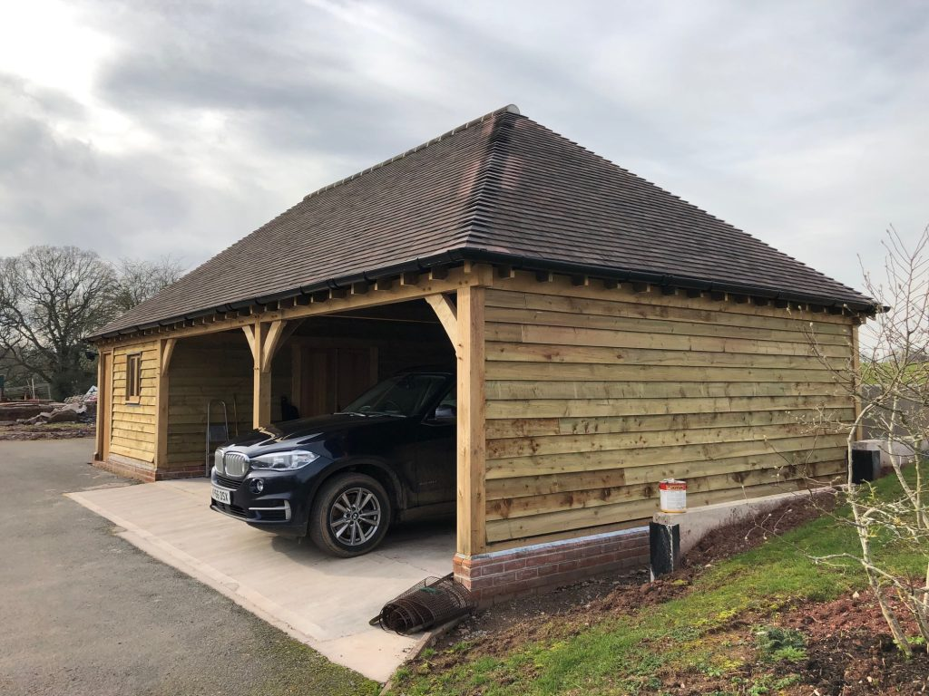Oak garage with hipped roof
