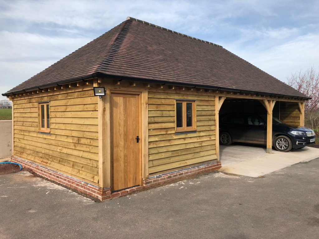 Triple bay oak framed garage with workshop