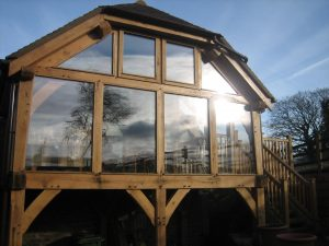 Glazed first floor oak framed extension with balcony