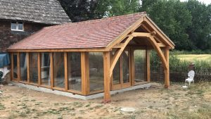 Oak and glass extension with curved truss porch area