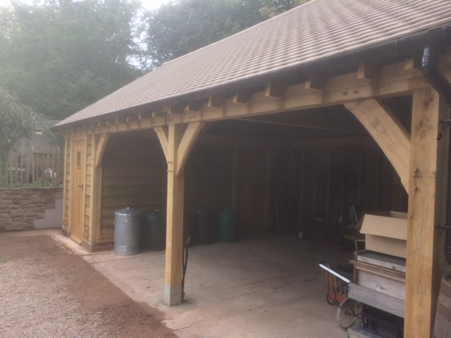 Three bay oak framed garage with workshop