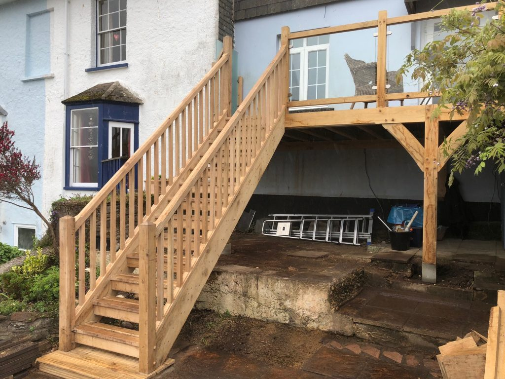 Oak Framed Balcony with oak stairs and glass balustrade in Dartmouth
