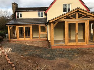 Glazed oak lean too and oak framed extension