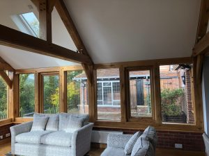 Oak and glass extension with king post truss