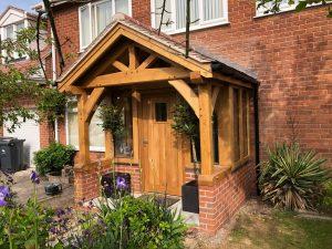 Enclosed oak porch with oak front door